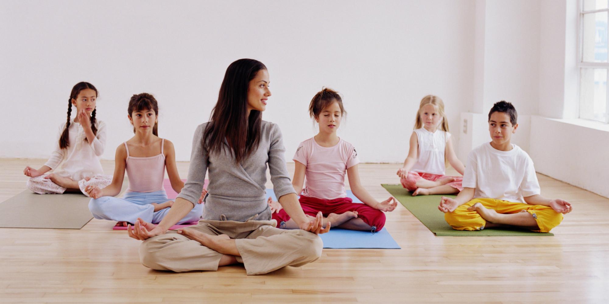 Woman Teaching Children 7 10 Yoga